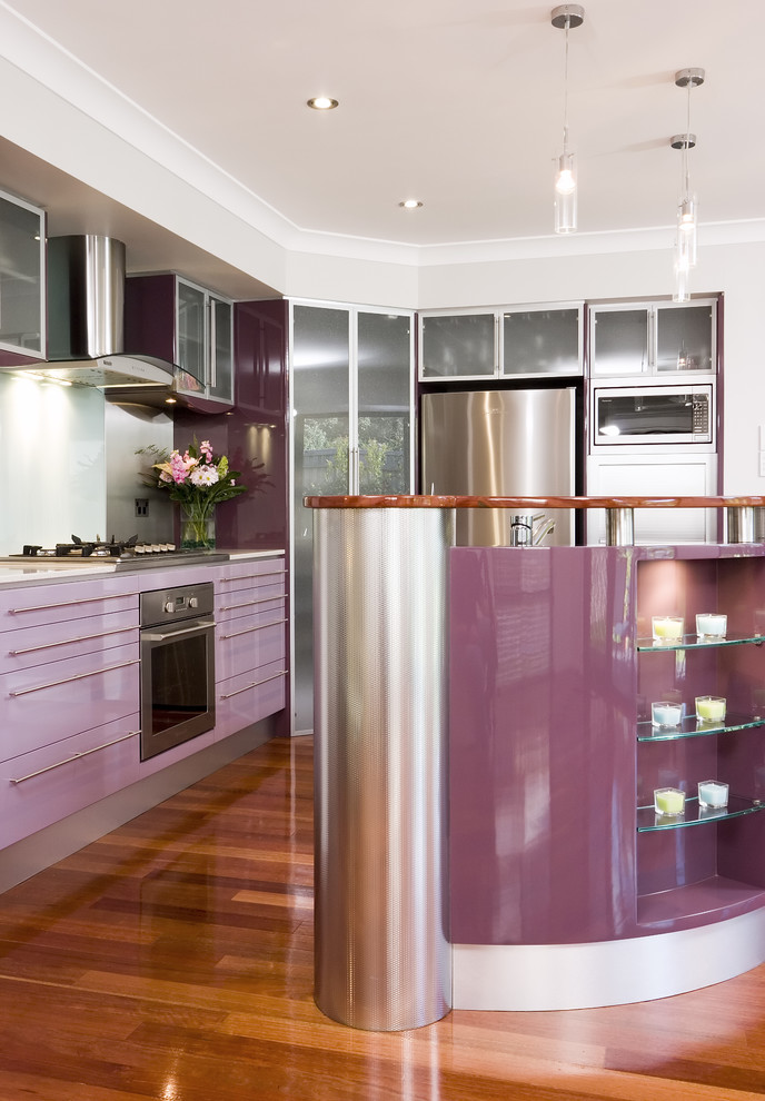 contemporary kitchen design with purple glass front cabinets stainless steel appliances purple glass mini bar with transparent glass shelves dark toned wood floors