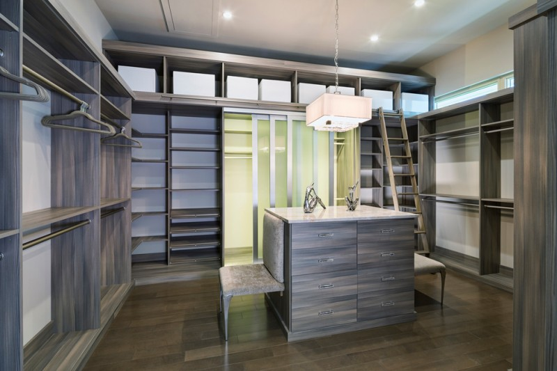 cool shabby grey wooden walk in closet organizer with built in ladder and two grey melamine chairs against the center table