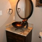 copper glass bowl sink, brown marble vanity, dark wooden cabinet, round mirror