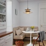 Corner Banquette Seating With Brown Sofa, A Wooden Chair With White Cushion, White Wooden Saarinen Style Table