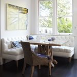 Corner Banquette Seating With White Corner Sofa, Wooden Square Table, A Rattan Cahir With Blue Cushion