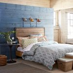 Country Bedroom With Siding Walls Blue Siding Wall System Industrial Loft Bed With Higher Headboard Colorful Bed Sheet And Shams Modern Gold Toned Wall Lamps Neutral Toned Area Rug