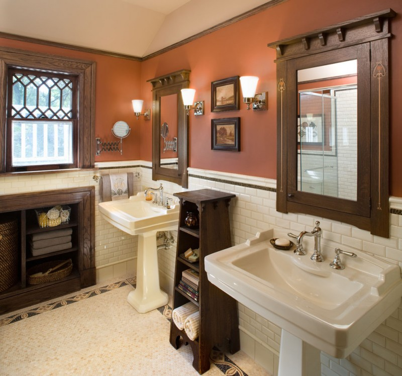 craftsman bathroom with white tiles flor, white tiles wainscoting, brown painted walls, brown wooden cabinet and shelves, two white wastafels with two mirror