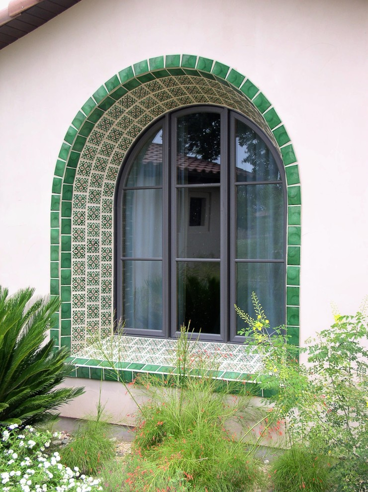 curved top exterior window idea with multi layers of artistic ceramic frames in green