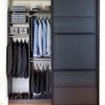 Custom Closet Organizer In Small Size Which Is Made Of Black Melamine Material Wood Colored Floors
