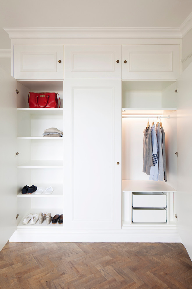 custom closet organizer in white with decorative mouldings