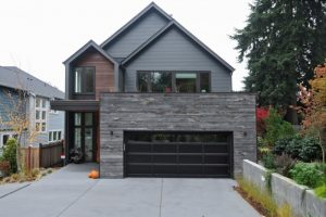 dark alumunium garage horizontally  veined wall grey siding brown siding wooden wall