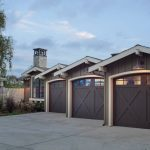 Dark Garage Wooden Three Garage Cream Trim Bronze Siding Outdoor Lights