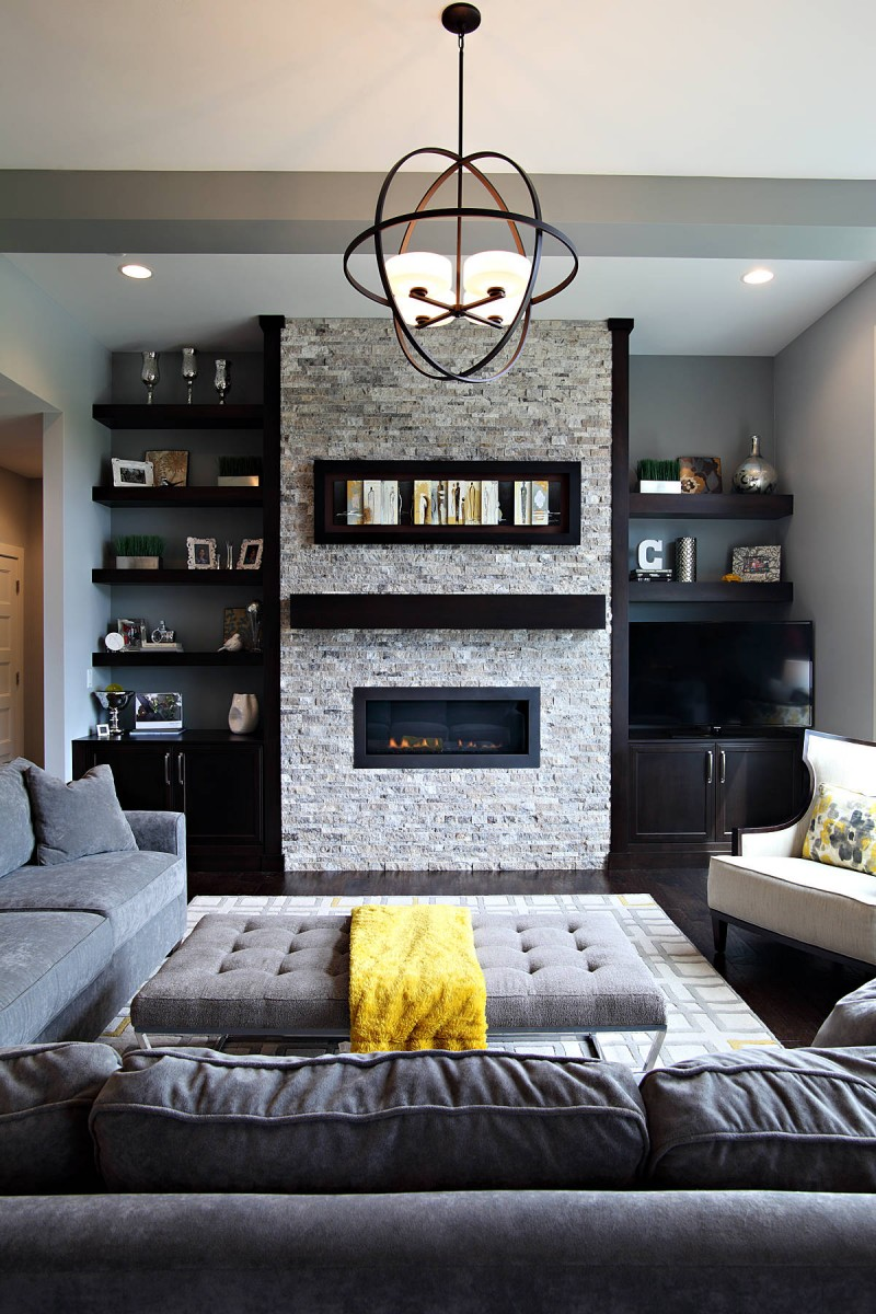 Ideal Living Room Model Dark Hardwood Floor Grey Sofa Modern Pendant Light Brick Fire Place Wall Open Floating Shelves