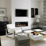 dark hardwood floor square coffee table white fire place wall grey sofa
