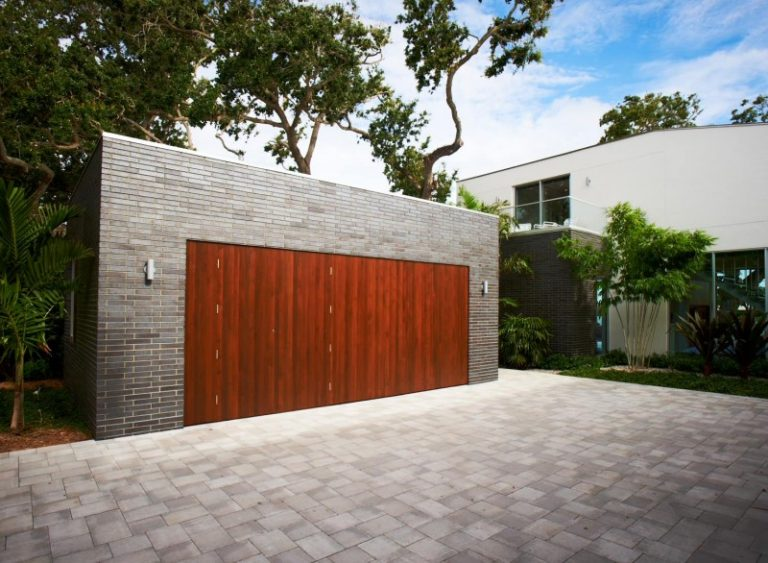 Elegant Dark Hardwood Garage Grey Tiled Brick Wall Brick Pave