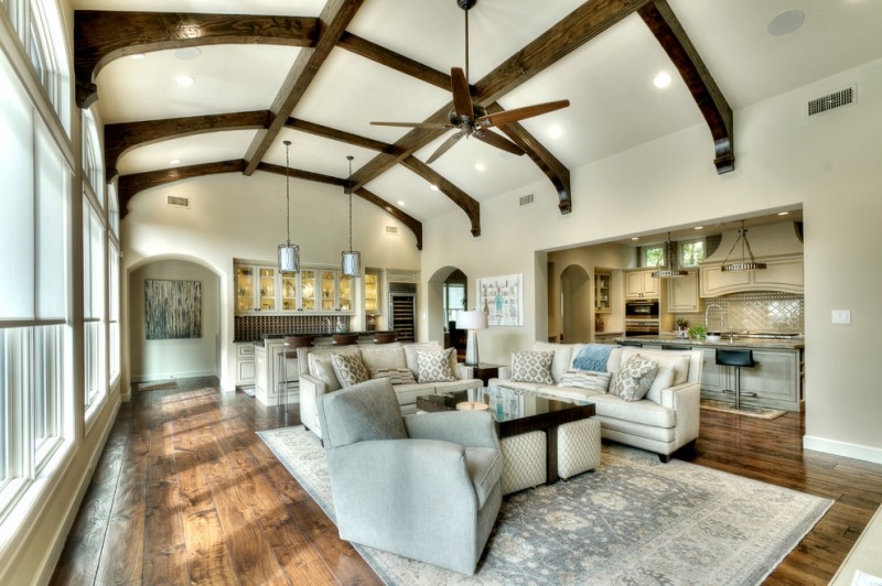 dark harwood floor grey sofa decorative archway area rug wine storage kitchen bar wood ceiling beams