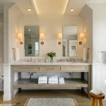 Desk Modeled Vanity Unit Mosaic Grey Wall Built In Shelves Two Wall Mirror Cove Lighting Wooden Stool Wooden Floor