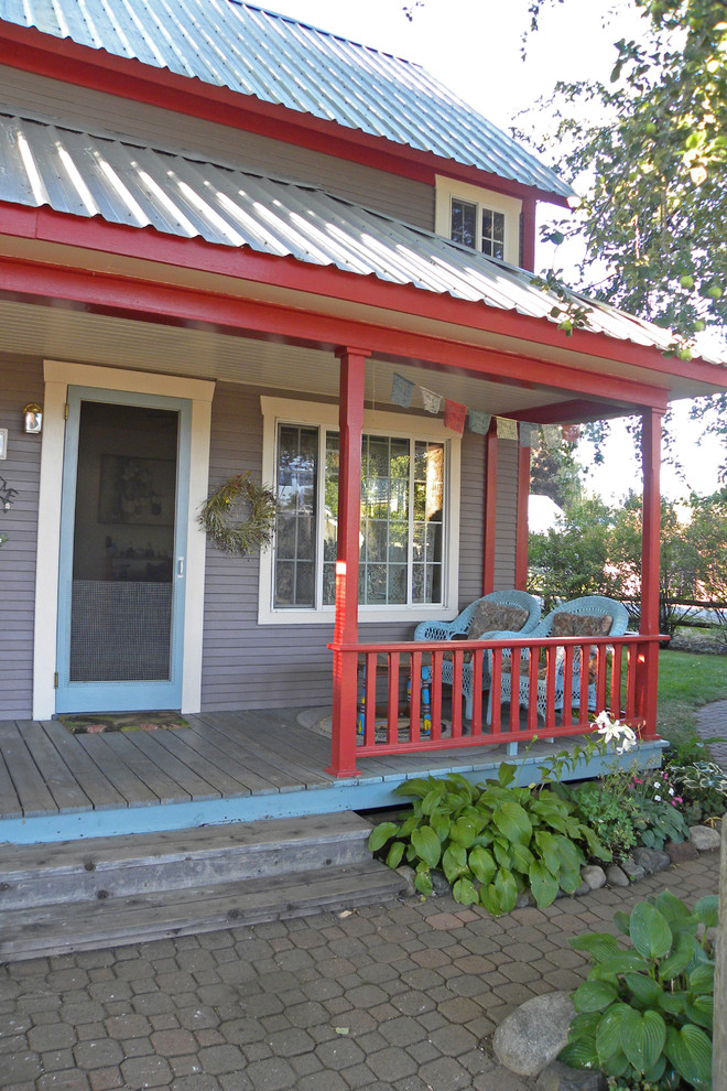 eclectic porch with grey exterior walls red railing system single front door with blue and white trims exterior glass window with white frames lightweight aluminum roofs