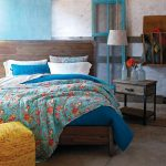 Edgy Bedroom With Colorful Bed Sheet And Shams Yellow Chair With Red Ornamental Scratches Industrial Wood Bed With Headboard Industrial Wood Bedside Table
