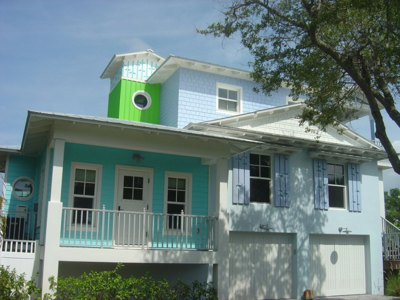 exterior paint with light blue, turquoise, and bright green on the wall, blue and white on the window frame, white on door, rail, and posts