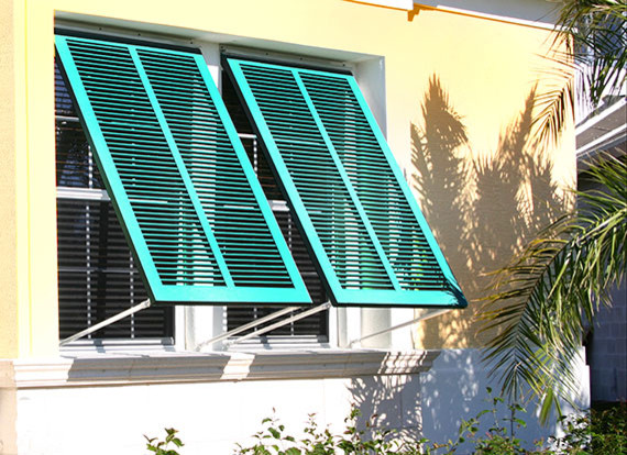 exterior windows with blue storm protections