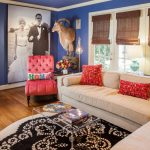 Family Room With Soft Beige Sofa Bright Red Accent Pillows Rounded Rug With Black Motifs Red Reading Chair Big Wedding Portrait Decorative Deer's Head Medium Toned Wooden Floors