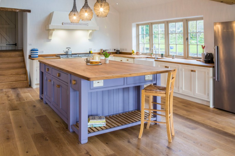 farmhouse kitchen idea purple kitchen island with wood top higher wood chair white cabinets wood countertop stainless steel appliances hardwood floors