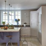 Farmhouse Kitchen Remodel With Beige Cabinets And Walk In Closet Purple Kitchen Island With Hardwood Top Round Top Stools