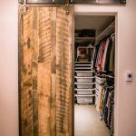 Farmhouse Style Dressing Room With Sliding Barn Door With Hardware Railing System Modern Walk In Closet In White