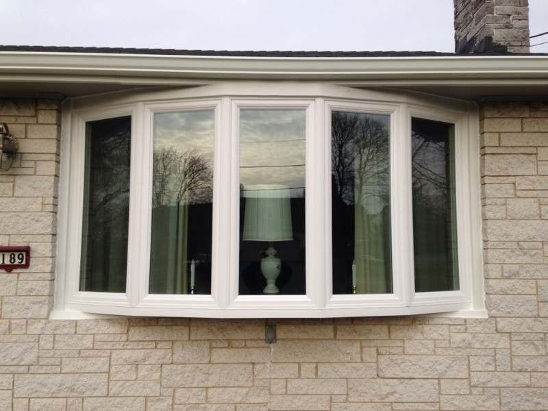 five series of bow windows with glass panels and white window trims