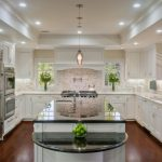 Floor To Ceiling White Cabinet Black Granite Countertop Granite Backsplash Dark Hardwood Floor