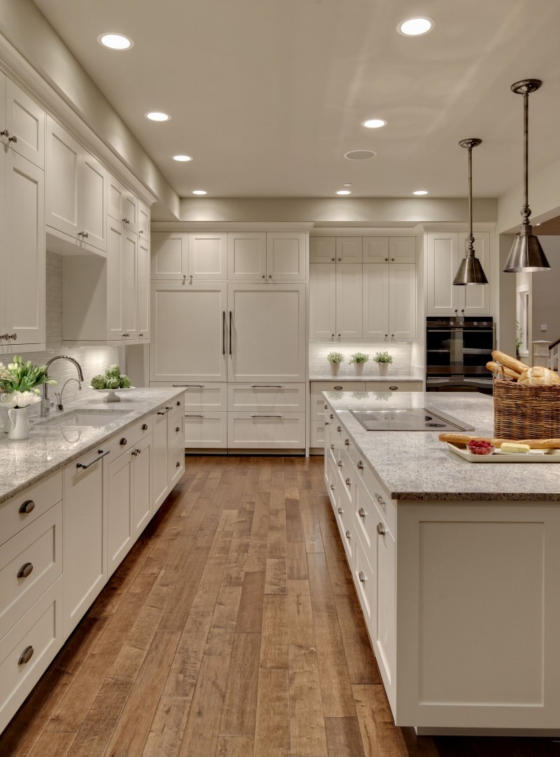 floor to ceiling white cabinet tiled dark hardwood floor granite countertop metal pendant lights