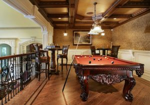 game room with billiard table, couples of table set, white pendant lamp