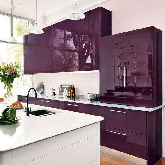 glossy purple cabinets with flat panel glossy white island white countertop white backsplash