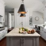 Grey Quartz Countertop White Kitchen Cabinets Wood Floor Clock Window Glass Doors Faucet Sink Chairs Table Pillows