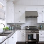 Grey Quartz Countertop White Kitchen Dark Floor Stove Wall Tile Cabinets Faucet Sink Window White Ceiling