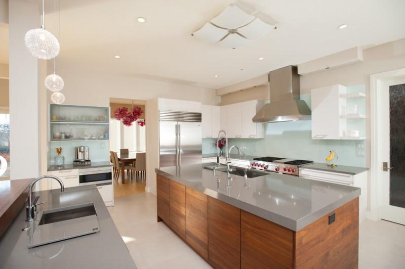 grey quartz countertop white kitchen faucet sink ceiling decor shelves stove door glass chairs table hanging lamps