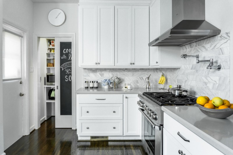 grey quartz countertop white kitchen small size wood floor stove drawers cabinet clock door glass
