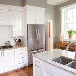 Grey Quartz Countertop White Kitchen Wood Floor Window Glass Drawers Faucet Sink Cabinets Stove Appliances