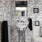 half bathroom with contemporary wallpaper with white backgournd and black lines, white toilet, white wink with high steel holder