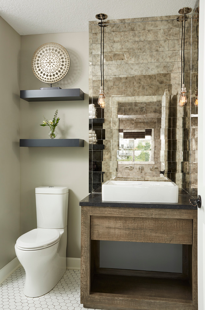 half bathroom with white tile flooring, white wall, white toilet, brown wooden table with white sink, mozaic tiles mirror, four yellow pendant light
