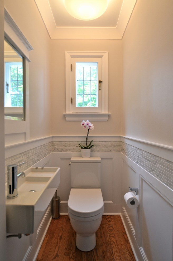 half bathroom with white walls, white wooden framed window, white wall mounted sink, white wooden framed square mirror, wooden floor