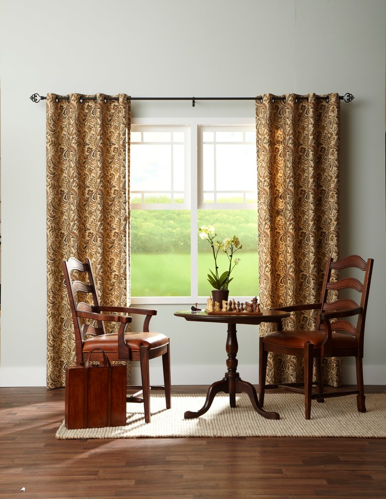 half window curtain in yellow with motifs black curtain rods pull up window with white trims a pair of wooden chairs round center table white rug medium tone wooden floors