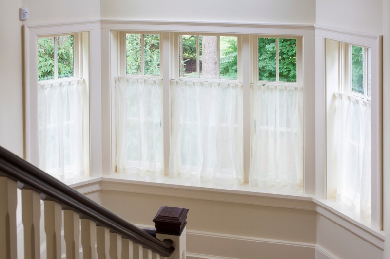 half window sheers in white glass windows with white trims