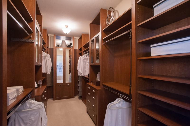 hardwood walk in closet with full features light beige interior