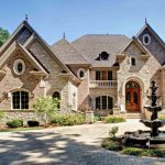 Hill Country House Plans Fountain Door Tall Windows Stairs Stones Oval Windows Roof Wood Glass