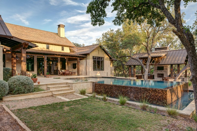 hill country house plans grass pool outdoor area table seating stairs door windows chimney pillars lights stones