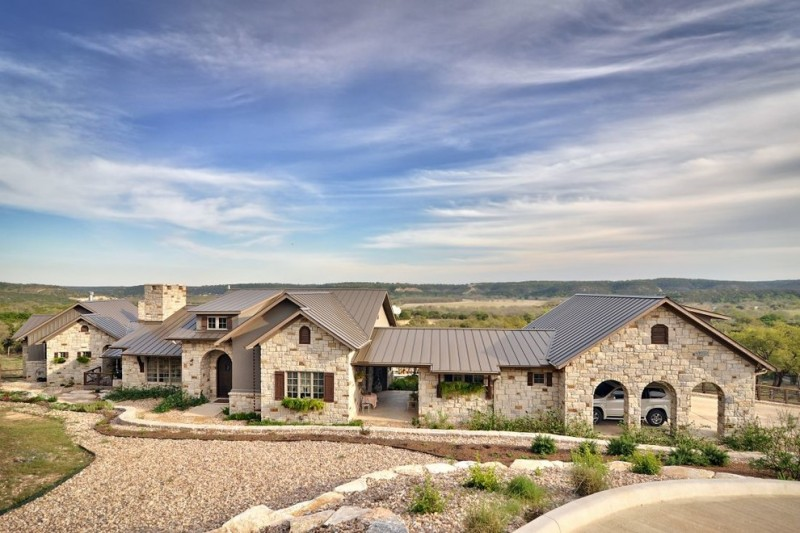 hill country house plans open garage sandstone roof outdoor area windows stone walls big house