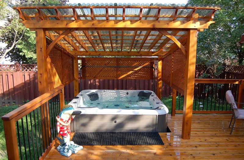 hot tub in the deck and cover it with wood rail half up and wooden ceiling