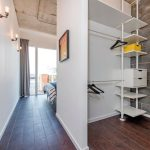 Industrial Walk In Closet Design In Hallway