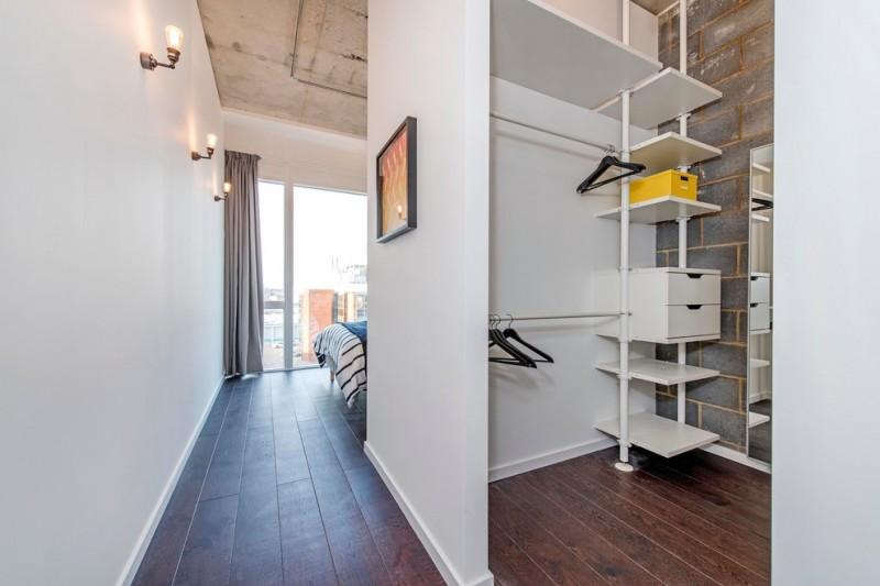industrial walk in closet design in hallway
