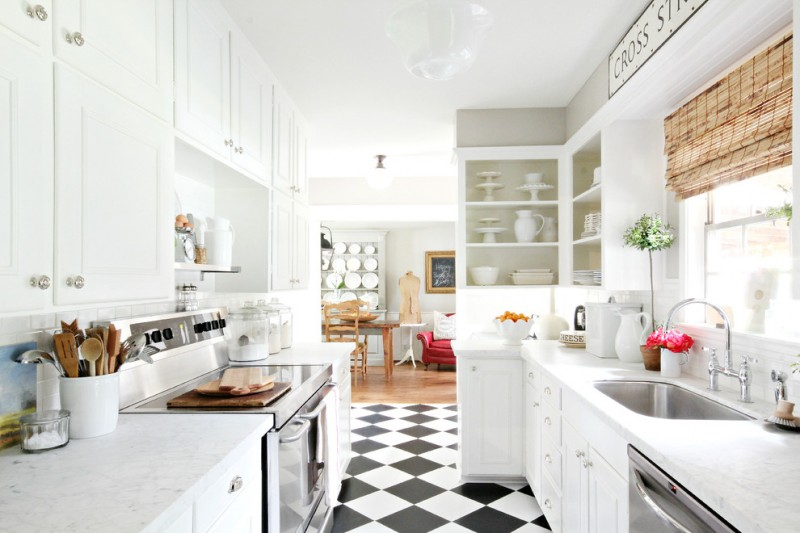 kitchen flooring checkered floor faucet sink sofa blinds appliances wall cabinets white stove lighting window
