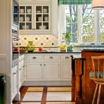 kitchen flooring windows dining chair wood hanging lamp storage space white cabinets trash bin wood frames
