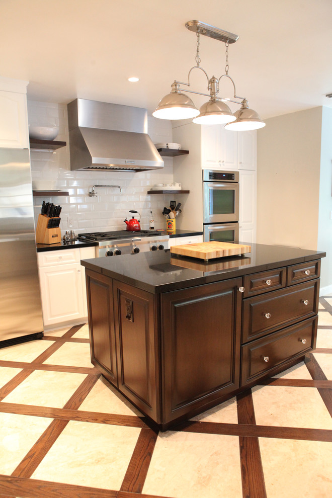 kitchen flooring wood frames crossing patterns cooking knives hanging lamps stove storage space drawers appliances